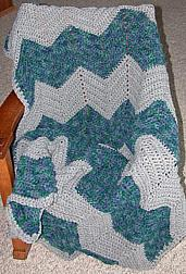Grey-green afghan on chair